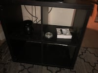 black wooden TV stand with flat screen television Reston, 20190