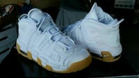 pair of white Nike Air Up Tempo basketball shoes