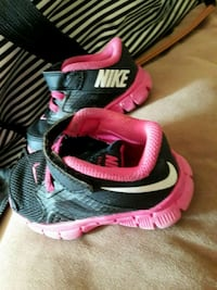 pair of black-and-pink Nike running shoes Dundalk, 21222
