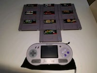 Nintendo SupaBoy portable SNES with 10 games.