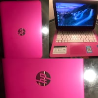 pink and white HP laptop