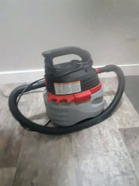 black and red canister vacuum cleaner 2471 km