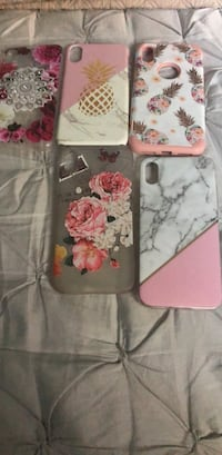 Five pink and white iphone cases 324 mi