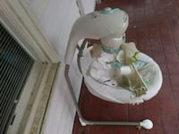baby's white and green cradle n swing 152 mi