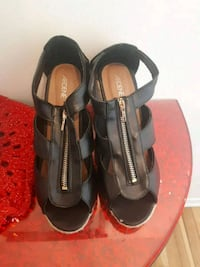 pair of black-and-brown leather sandals Côte Saint-Luc, H4W 1M3