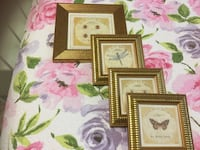 four gold wooden photo frames