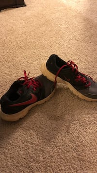 pair of black-and-pink Nike running shoes Piedmont, 29673