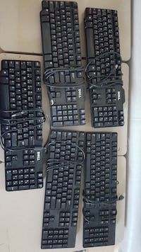 five black Dell corded computer keyboards Laval, H7P 3A7