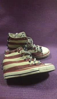 pair of brown-and-white adidas sneakers 596 mi