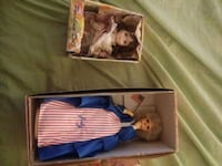 two brown and blue dressed dolls in box Baltimore, 21225