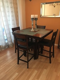 Rectangular brown wooden table with four chairs dining set Toronto, M2M 0B5