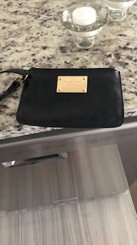 Mk tiny clutch  leather new  Laval