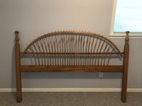 brown wooden bed headboard and footboard null