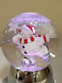 SKATING SNOWMAN in Lighted Water Globe - $10 w/o batteries (firm).