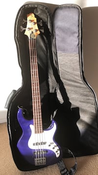 purple 4-string electric bass guitar with gig bag Lancaster, 93536