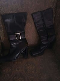 pair of black leather square-toe chunky-heeled knee-high boots