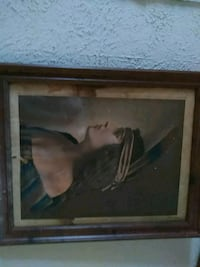brown wooden framed painting of woman 872 mi