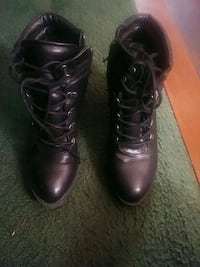 pair of black leather boots Los Angeles, 90047