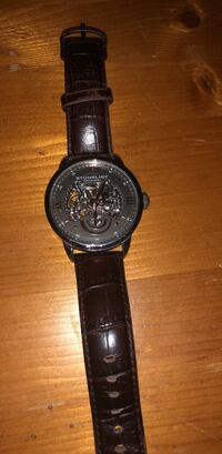 round black chronograph watch with black leather strap Sherrills Ford, 28673