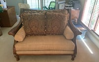 Designer love seat with cushions.