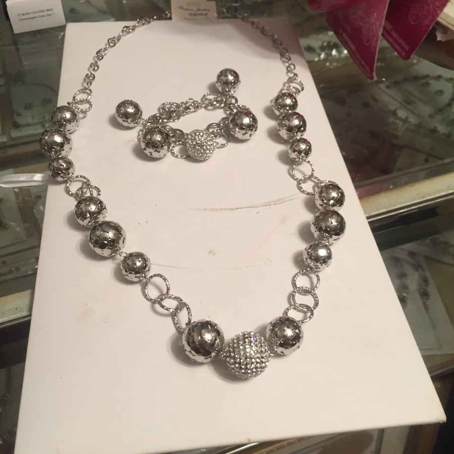 Silver-colored chain necklace and bracelet
