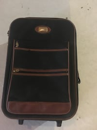 Black and brown soft case luggage