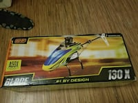yellow and blue Blade helicopter RC toy box