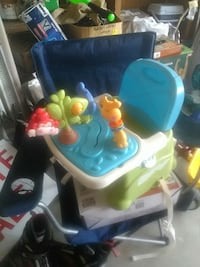 baby's red,blue,yellow and green animal themed highchair Apopka