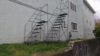 2 rolling ladders for warehouse