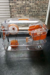 hamster cage with food and bedding