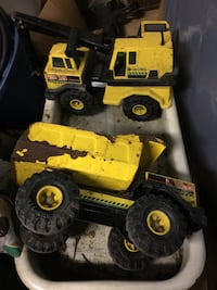 Two yellow and black tonka heavy equipments