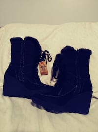 pair of black wedge boots