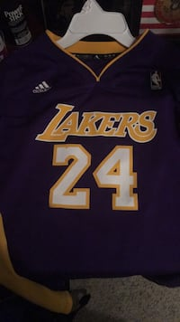 blue and white Los Angeles Lakers 24 jersey 257 mi