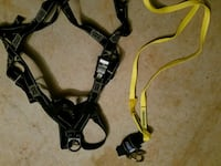 two yellow and black safety harnesses