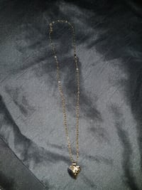 gold-colored heart pendant necklace