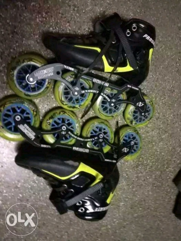 black-and-green inline skates