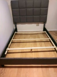 brown and black wooden bed frame 20 mi