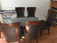 Solid Elegant Glass Dining room table with 6 chairs Surrey, V3S 1P5