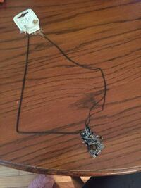 Black chain necklace with silver dangles with black jeweled earrings  Nashville, 37221