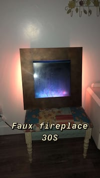 Faux fireplace with remote to change colors and settings  Clearfield, 84015
