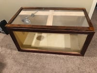 Rectangular brown wooden framed glass top coffee table Niceville, 32578