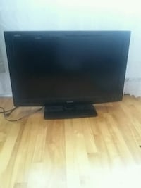 black flat screen TV with remote Montreal, H2W