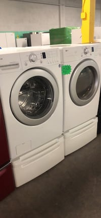 LG front load washer and dryer set with pedestal 4 months warranty