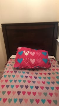 2 twin matching beds.head boards and bed frames