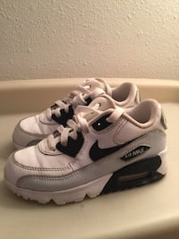 white-and-black Nike Air Max low-tops