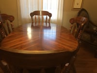 oval brown wooden dining table with chairs London, N6C 3E1