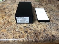 black iPad with box and case