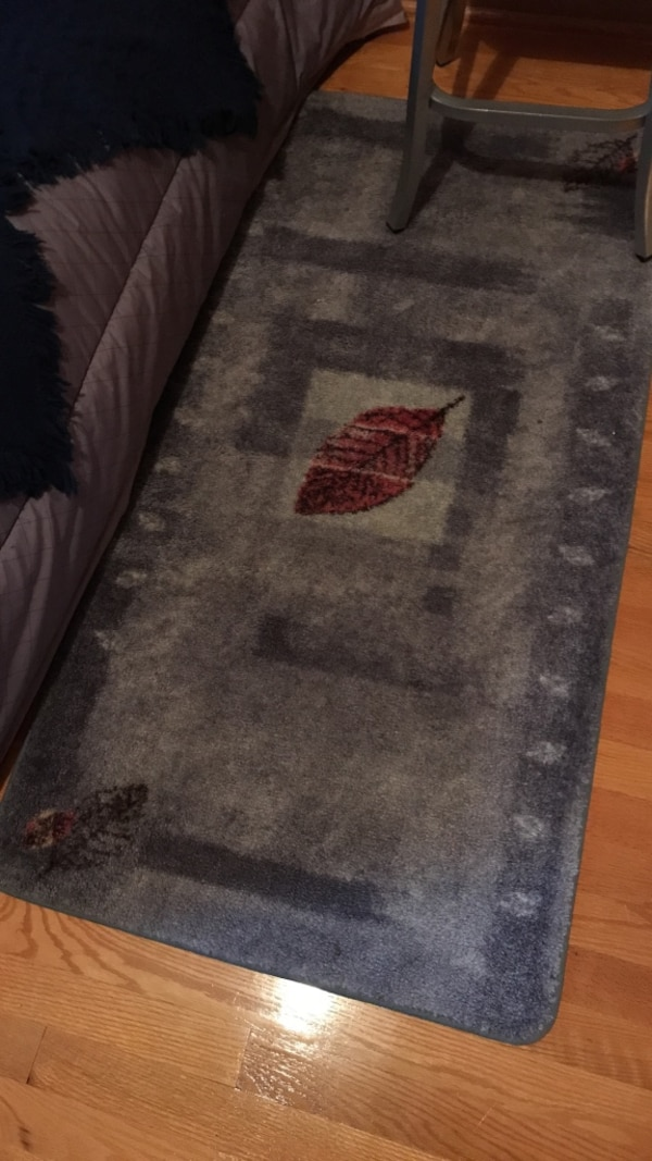 black,gray,and red printed floor rug a2be55b9-b728-4e10-badb-77d5c82d3436
