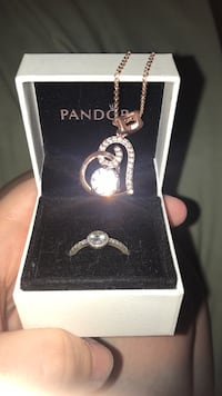 Silver-colored pandora ring with heart pendant necklace and white case