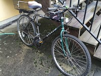 10 speed bicycle with combo lock and rear basket and phone caddy thing Vancouver, V5R 4Y4